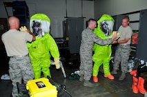 Members of the 134th Air Refueling Wing Civil Engineer Squadron Emergency Management team suit up in their equipment to conduct a hazardous material exercise during training at Joint Base Pearl Harbor- Hickam, Hawaii August 03-17.  (U.S. Air National Guard photo by Master Sgt. Kendra M Owenby/Released)