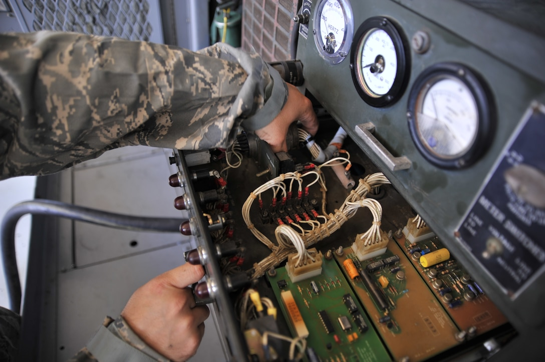 MAXWELL AIR FORCE BASE, Ala. -- Staff Sgt. Joshua Jones, 908th Maintenance Squadron aerospace ground equipment technician, checks wires inside an A/M32A-86 generator Sept. 19, 2013, here. The generator can produce enough power to turn on and test the electrical systems on a C-130 Hercules. (U.S. Air Force photo by Senior Airman Natasha Stannard/Released)
