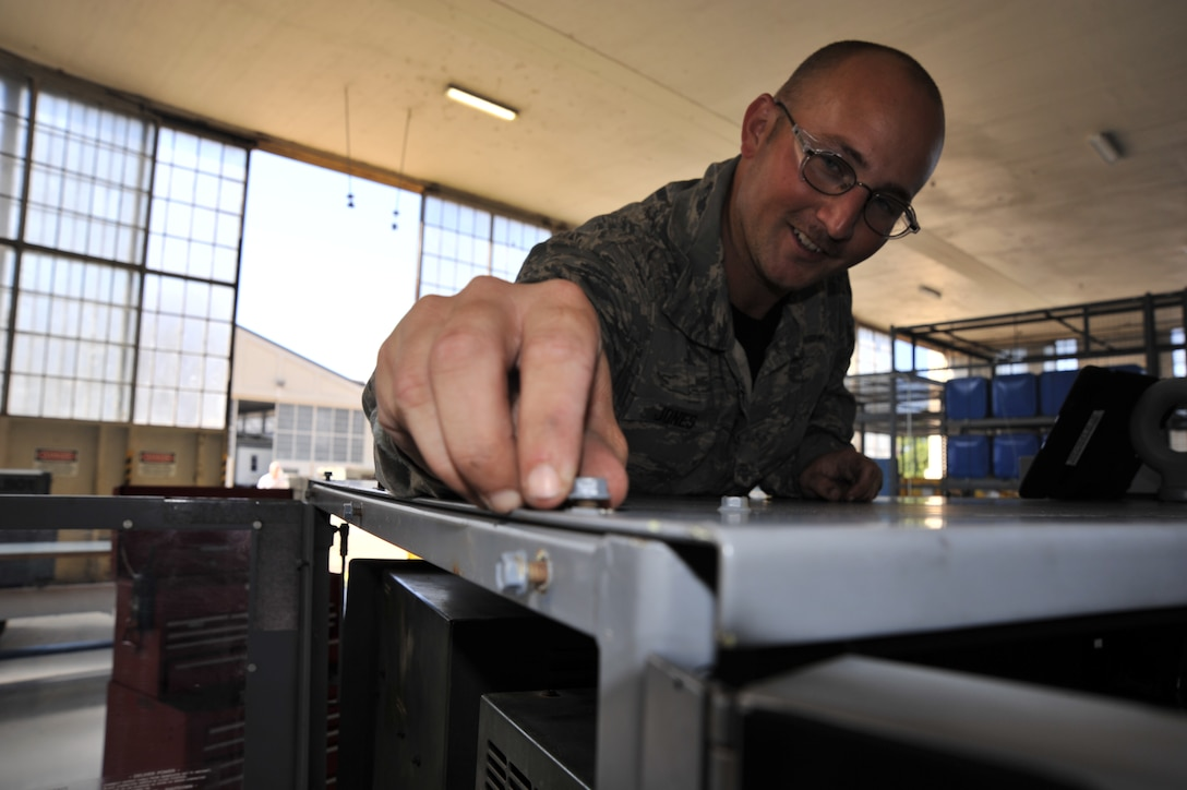 MAXWELL AIR FORCE BASE, Ala. -- Staff Sgt. Joshua Jones, 908th Maintenance Squadron aerospace ground equipment technician, checks that a bolt is securely tightened on an A/M32A-86 generator during a routine maintenance inspection. During these inspections AGE technicians must check the generator's fluid levels, wiring and hardware to ensure the units can deliver the power needed by the aircraft. (U.S. Air Force photo by Senior Airman Natasha Stannard/Released)