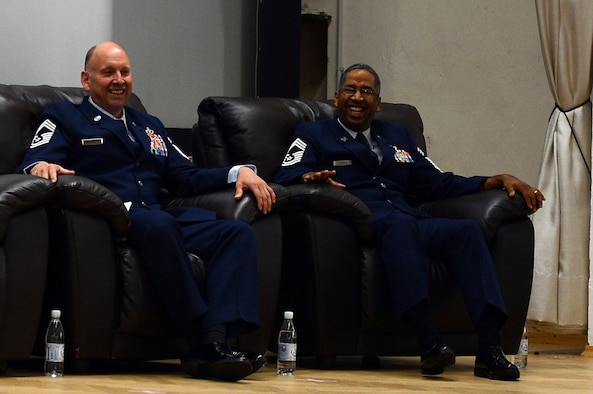 SPANGDAHLEM AIR BASE, Germany— U.S. Air Force Lt. Col. Bradley Johnson, 52nd Civil Engineer Squadron commander, presents Chief Master Sgts. Leslie Jones and Louis Suarez, both with the 52nd CES, with Meritorious Service Medals at their joint retirement ceremony at the Spangdahlem theater Aug. 29, 2013. Friends, family and coworkers filled the base theater to honor their collective 60 years in the Air Force. (U.S. Air Force photo by Senior Airman Alexis Siekert/Released)