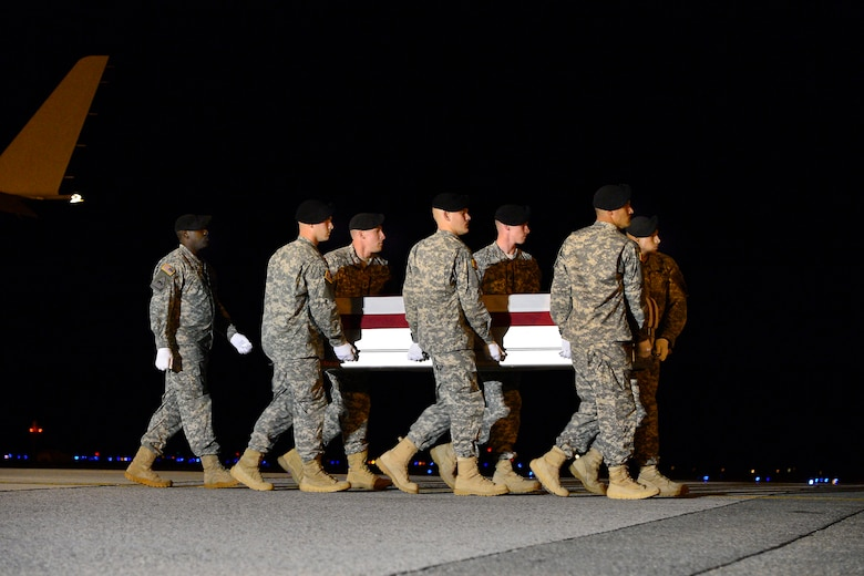 A U.S. Army carry team transfers the remains of Army Spc. Joshua J. Strickland, of Woodstock, Ga., at Dover Air Force Base, Del., Sept. 23, 2013. Strickland was assigned to the Company D, 1st Special Forces Battalion, 1st Special Forces Group Fort Lewis, Wash. (U.S. Air Force photo/David Tucker)