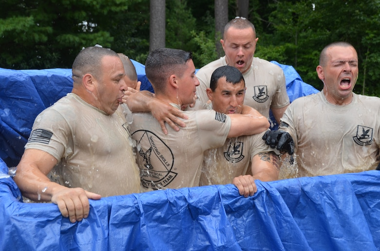 Members of the 103rd Security Forces Squadron emergency services team endure an ice-water plunge at the West Hartford Reservoir as part of the Connecticut SWAT Challenge Aug. 22, 2013. The ice bath was just one of many physically grueling obstacles competitors faced. (U.S. Air National Guard Photo by Maj. Bryon Turner)