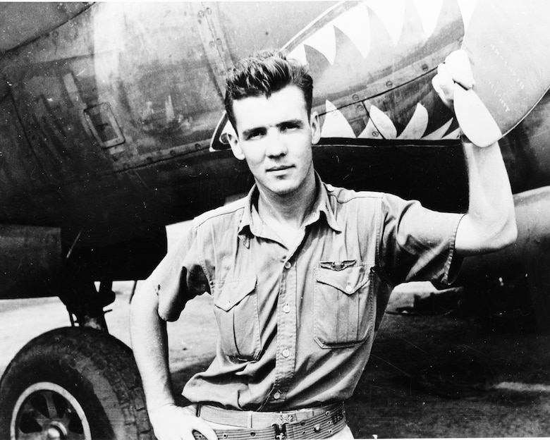 U.S. Army Air Corps Lt. Col. Thomas J. Lynch stands by a P-38 Lightning on the flightline at Papua, New Guinea in 1943. Lynch was a fighter pilot during World War II and a part of the 39th Fighter Squadron in the 35th Fighter Group, known today as the 35th Fighter Wing. Lynch was the top ace for the 39 FS, and during his time with the 35 FG he scored 20 aerial victories. On March 8, 1944, anti-aircraft fire at a low altitude damaged his P-38 and he had to bail out of his aircraft. Because of the low altitude his parachute could not open effectively and he and his aircraft were lost in the jungle below. Declared missing in action, Lynch was never found and is still classified as MIA today. (Courtesy photo by U.S. Army Air Forces, Washington, D.C.)
