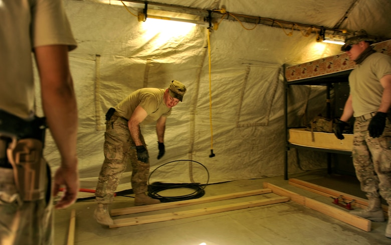 Master Sgt. Douglas Threatt, 455th Expeditionary Communications Squadron, frames out a computer tower for a future communication equipment room on Bagram Airfield, Afghanistan. The room will contain networking equipment providing connectivity for the Jordanian forces. Threatt is deployed from Ramstein Air Base, Germany.