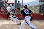 An All-Army Women's base runner beats a throw home as the All-Navy catcher waits for the ball during the Armed Forces Softball Tournament Sept. 15 at Cannoneer Complex.
