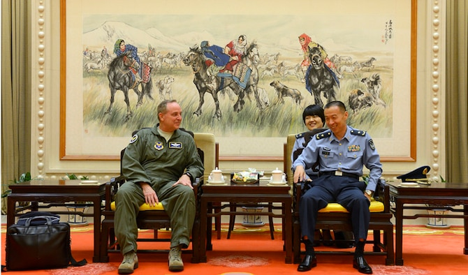 "Air Force Chief of Staff Gen. Mark A. Welsh III meets with People's Liberation Army Air Force Deputy Chief of Staff Maj. Gen. Li Chunchao after arriving Sept. 24, 2013, in Beijing, China. Welsh, along with Gen. Herbert ""Hawk"" Carlisle and Chief Master Sgt. of the Air Force James A. Cody will visit with various military leaders as part of a weeklong trip."