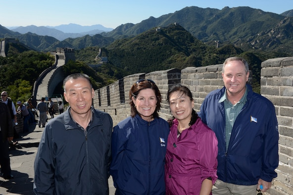 "Air Force Chief of Staff Gen. Mark A. Welsh III, his wife, Betty, People's Liberation Army Air Force Deputy Chief of Staff Maj. Gen. Li Chunchao, and his wife, Han Yan, stand at the Great Wall in China, as part of a cultural tour Sept. 24, 2013.  Welsh, along with Gen. Herbert ""Hawk"" Carlisle and Chief Master Sgt. of the Air Force James A. Cody will visit with various military leaders as part of a weeklong trip."