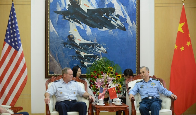 "Air Force Chief of Staff Gen. Mark A. Welsh III meets with People's Liberation Army Air Force Commander Gen. Ma Xiaotian Sept. 25, 2013 in Beijing, China. Welsh, along with Gen. Herbert ""Hawk"" Carlisle and Chief Master Sgt. of the Air Force James A. Cody will visit with various military leaders as part of a weeklong trip. (U.S. Air Force photo/Scott M. Ash)"