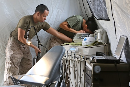 Petty Officer 3rd Class Ralph Villamor, left, and Petty Officer 3rd Class Raquel Patino, right, dental technicians with 1st Dental Battalion, 1st Marine Logistics Group, set up dental equipment during a field exercise conducted by 1st Dental Bn., 1st MLG, aboard Camp Pendleton, Calif., Sept. 20, 2013. To prepare themselves to operate in a combat environment, the dentists and corpsmen brought crucial equipment to the field such as a field X-ray, a complete dental operatory and a sterilization machine.