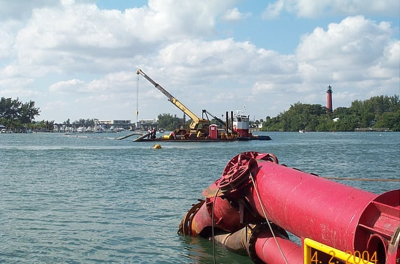 Dredging of the Intracoastal Waterway is accomplished with a cutter suction dredge, which is propelled forward by spuds at the rear of the dredge. Anchor booms allow the dredge to turn and maneuver.