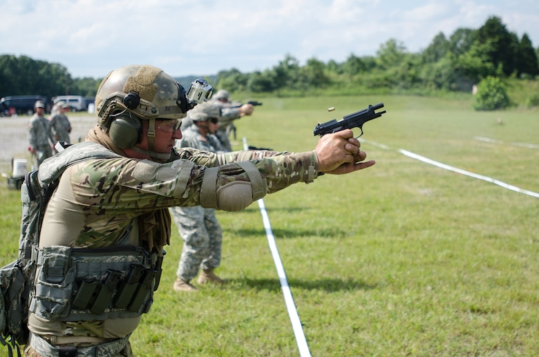 Senior Master Sgt. John Siebert, standardization and evaluation loadmaster for the Kentucky Air National Guard's 165th Airlift Squadron and rifle team captain for the 123rd Airlift Wing's marksmanship team, fires his M9 pistol during the Adjutant General's Kentucky National Guard State Rifle and Pistol Training Event on July 27, 2013, at Fort Knox, Ky. Fifteen Airmen from the 123rd Airlift Wing competed in the contest July 27 and 28. The 123rd took first place in the pistol team competition, rifle team competition and overall aggregate. (U.S. Air National Guard photo by Master Sgt. Phil Speck)