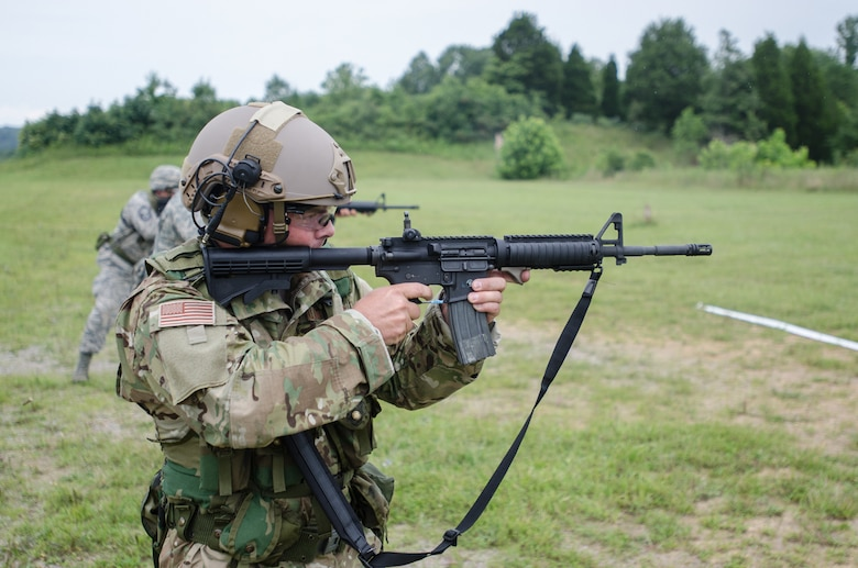 Tech. Sgt. Don Yeats, a radio frequency transmission craftsman from the 123rd Special Tactics Squadron, fires an M4 rifle during the Adjutant General's Kentucky National Guard State Rifle and Pistol Training Event on July 27, 2013, at Fort Knox, Ky. Fifteen Airmen from the 123rd Airlift Wing competed in the contest July 27 and 28. The 123rd took first place in the pistol team competition, rifle team competition and overall aggregate. (U.S. Air National Guard photo by Master Sgt. Phil Speck)