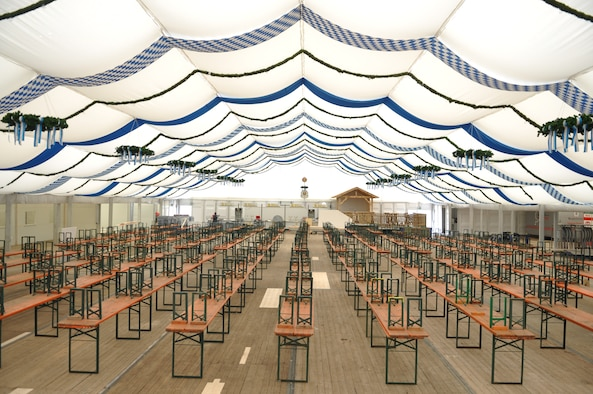 """SPANGDAHLEM AIR BASE, Germany -- Silence at one of the three empty tent halls for the Wittlich October festival after ongoing preparations. This will change, Friday, Sept. 27, 7 p.m., when the festival kicks off. At this time, the mayor will open the first keg of beer and shout out the most famous Bavarian words """"Ozapft is,"""" This means that the festival is then officially open. Free beer will be served. A band will lead in activities soon afterwards. Although it is not a must, some people will dress up in Bavarian outfits to blend in and enjoy the fun. (U.S. Air Force photo by Iris Reiff)"""