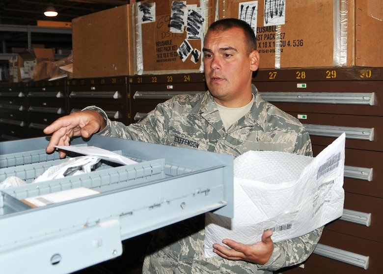 Staff Sgt. James Steffenson, a fuels maintenance specialist with the 120th Fighter Wing in Great Falls, Mont., sorts incoming parts for the 120th Logistics Readiness Squadron. He volunteered to assist the squadron during the wing conversion to the C-130 Hercules air transport mission. National Guard photo/Senior Master Sgt. Eric Peterson.