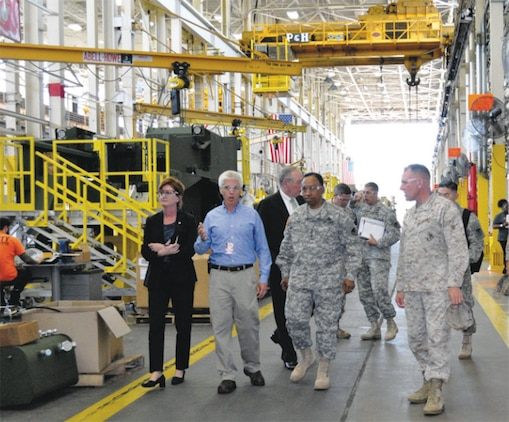 Army Materiel Command Commanding General Gen. Dennis L. Via joins Marine Corps Logistics Command Commanding General Maj. Gen. John J. Broadmeadow for a tour of Production Plant Albany in Albany, Ga., Sept. 12. The leaders discussed collaborative efforts to support the joint warfighter.
