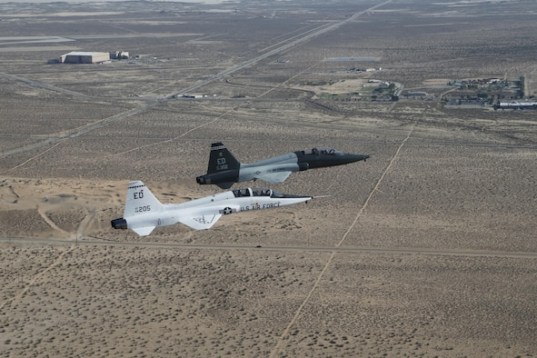 T-38 A-model and T-38 C-model are flown in formation one last time at Edwards Air Force Base, Calif., Sept. 19, 2013. (U.S. Air Force courtesty photo/Bobbi Zapka)
