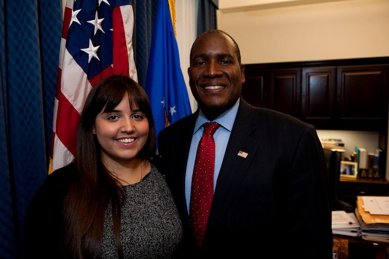 Air Force intern Natalie Labayen poses with her supervisor, Dr. Jarris Taylor, who's the Deputy Assistant Secretary of teh Air Force for the Strategic Diversity Integration office, Sept. 13, 2013 in the Pentagon.  Labayen recently won a Department of Defense award for her significant contributions in the Air Force Strategic Diversity Integration Office. Labayen, who has an autoimmune disease, won the Judith C. Gilliom Award, presented by the Workforce Recruitment Program Award Ceremony Aug 2.