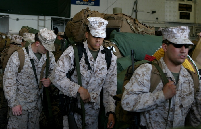 Marines with the 31st Marine Expeditionary Unit walk past a stack of bags while disembarking the USS Bonhomme Richard (LHD 6) to end their regularly scheduled Fall Patrol here, Sept. 25. The unit returned after spending nearly three months patrolling the Asia-Pacific region and conducting bilateral training exercises with the Australian Defense Forces. The 31st MEU is the only continuously forward-deployed MEU and is the Marine Corps' force in readiness in the Asia-Pacific region.