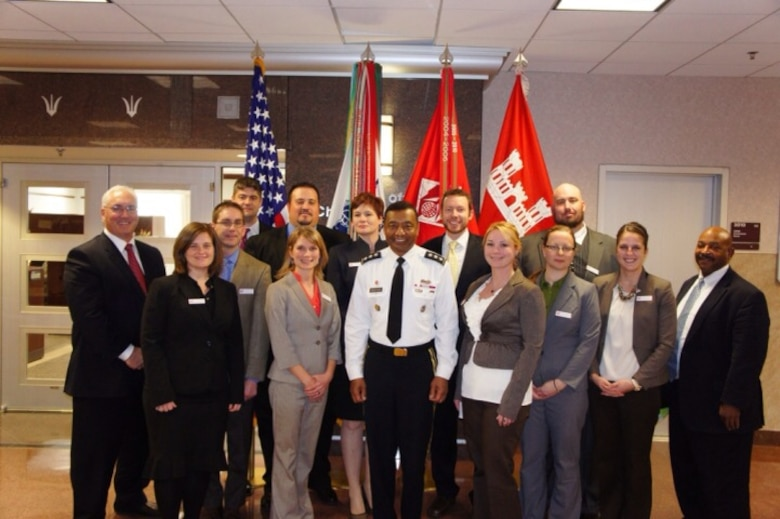 2013 Planning Associates at the USACE Headquarters with LTG Bostick, USACE Commanding General, and Tab Brown, Chief of Planning and Policy Division.  Back row, left to right: Tom Maier (Pittsburgh), Andrew Roach (Baltimore), Byron Rupp (New England), Travis Creel (New Orleans), Janet Cote (Norfolk), Thomas Topi (St. Louis), and Jason Norris (Alaska), Front row: Marci Jackson (Sacramento), Sierra Schroeder (St. Paul), LTG Bostick (USACE Commanding General), Courtney Reed (New Orleans), Sara Brodzinsky (Chicago), Rachel Mesko (Seattle), and Tab Brown (USACE Chief of Planning and Policy Division)