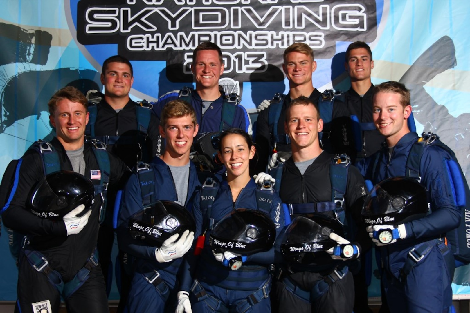 Air Force Teams Euphoria and Conundrum pose for a photo at the U.S. Parachute Assocation National Skydiving Championships 2013, which took place in Chicago from September 11-22, 2013.  The teams are a part of the Wings of Blue -- The U.S. Air Force Parachute Team.  The Wings of Blue are based out of the U.S. Air Force Academy, Colo., and operated by the 98th Flying Training Squadron, whose mission is to develop character and leadership in cadets through the sport of parachuting.  (Courtesy Photo)