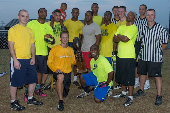 Members of the 314th Aircraft Maintenance Squadron intramural flag football team pose for a group photo after defeating the 19th Aircraft Maintenance Squadron 41-21 Sept. 18, 2013, at Little Rock Air Force Base, Ark. (U.S. Air Force photo by Staff Sgt. Russ Scalf)