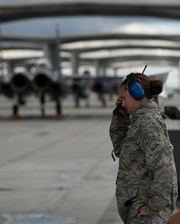 U.S. Air Force Capt. Angelina Stephens, 366th Aircraft Maintenance Squadron officer-in-charge of the 391st Aircraft Maintenance Unit, listens to the radio before an aircraft launch Sept. 25, 2013, at Mountain Home Air Force Base, Idaho. Stephens was recently awarded the Air Combat Command Lance P. Sijan Leadership award for successfully leading the Air Force's largest F-15E maintenance unit, directly responsible for 322 Airmen and 26 F-15s. (U.S. Air Force photo by Senior Airman Benjamin Sutton/Released)