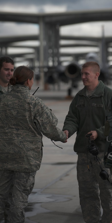 U.S. Air Force Capt. Angelina Stephens, 366th Aircraft Maintenance Squadron officer-in-charge of the 391st Aircraft Maintenance Unit, shakes hands with Airman 1st Class Chase Middleton, 366th AMXS crew chief, Sept. 25, 2013, at Mountain Home Air Force Base, Idaho. Stephens recently received the Air Combat Command Lance P. Sijan Leadership Award. (U.S. Air Force photo by Senior Airman Benjamin Sutton/Released)