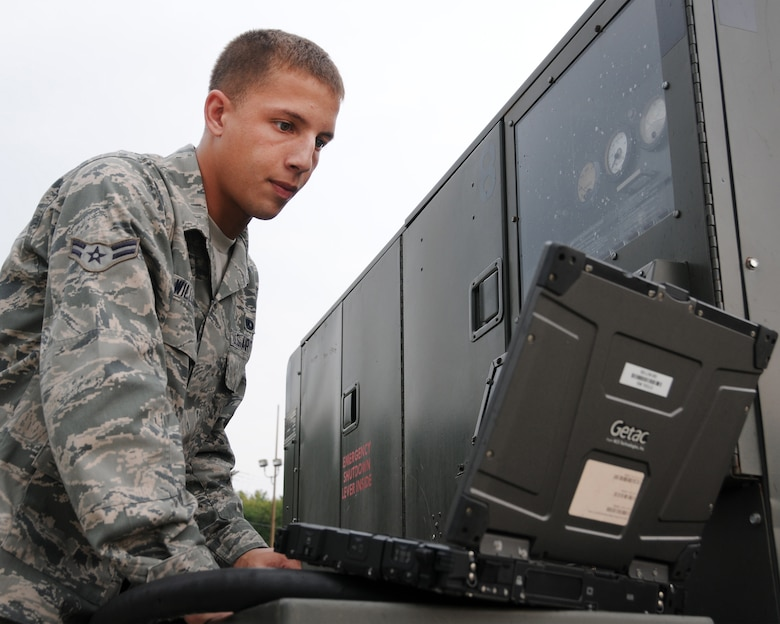 Airman 1st Class Joshua Williams performs a service inspection on aircraft generation equipment, Pease Air National Guard Base, N.H., September 12 2013.  (U.S. Air National Guard photo by Staff Sgt. Curtis J. Lenz)