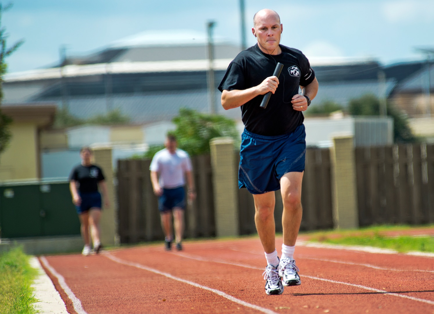 Col. Steve Taylor, Dental Support Squadron commander, runs his leg of the Prisoner of War/Missing in Action relay race September 20, at Joint Base San Antonio-Lackland. The Airman run a 24 hr. relay race which culminates in a baton handoff to awaiting families members of past and present POW/MIA's. (U.S. Air Force photo by Benjamin Faske/released)