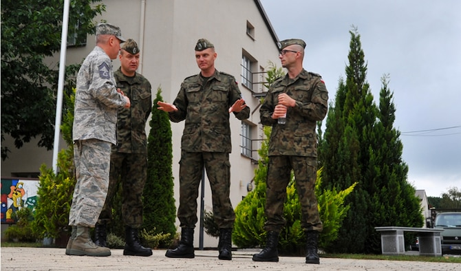Chief Master Sgt. Christopher Moore (far left), Kisling NCO Academy commandant, gives a tour to Warrant Officer 1st Class Krzysztof Gadowski (second from right) and his staff Sept. 17, 2013, at Kapaun Air Station, Germany. The visit gave the Polish senior NCO leaders a chance to further military relations and improve military education programs for Polish airmen.