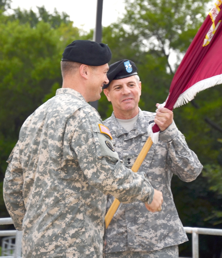 Maj. Gen. Steve Jones (right), incoming commanding general for the Army Medial Department Center and School, smiles as he accepts the colors from Maj. Gen. Brian Lein, Army deputy surgeon general and deputy commanding general  for operations, U.S. Army Medical Command, at a change of command ceremony Sept. 19 at the Army Medical Department Museum. (Photo by Esther Garcia, U.S. Army Medical Department Center and School Public Affairs)