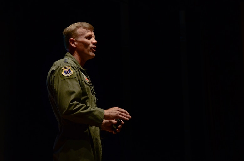 Lt. Gen Tod Wolters, Commander 12th Air Force (Air Forces Southern), addresses his Airmen during a commander's call on Davis-Monthan AFB, Ariz., Sept. 26, 2013.  Wolters final takeaways for the commander's call were to keep in mind family support, encourage diversity, discourage discrimination, and to remember our goal is to win America's wars.  (U.S. Air Force photo by Staff Sgt. Heather R. Redman/Released)