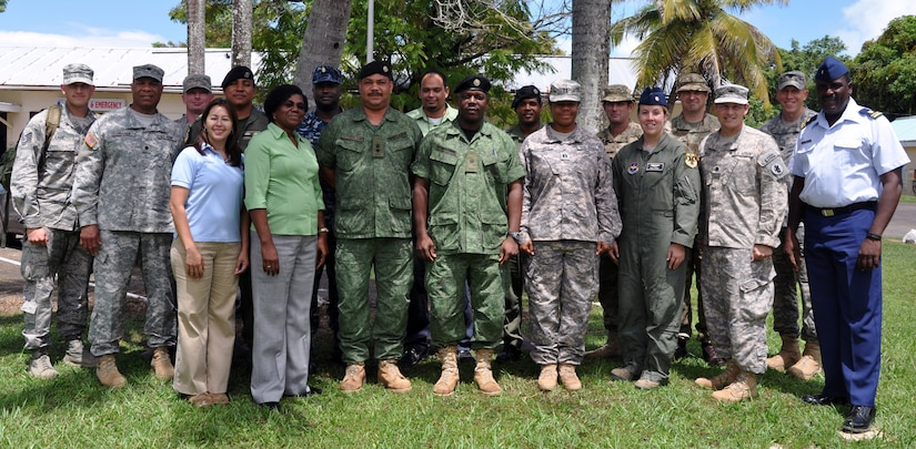 Members of Joint Task Force-Bravo's Central America Survey and Assessment Team (C-SAT) pose with representative from the Belize Defence Forces, the British Army, the National Emergency Management Organization (NEMO) and the Office of Foreign Disaster Assistance (OFDA) in Belize, Sept. 27, 2013.  The C-SAT participated in a disaster response exercise with a focus on increasing the coordinatino between the various military and disaster response entitites in order to alleviate human suffering in the event of a real world disaster.  (U.S. Air force photo by Capt. Zach Anderson)