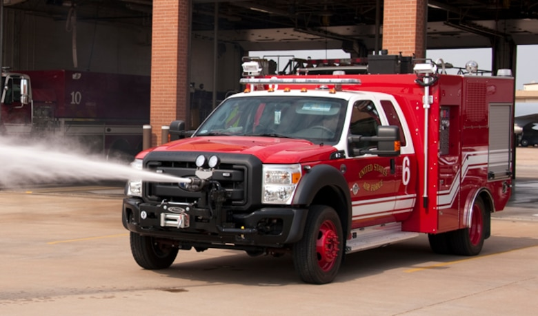 Firefighter Carl Lamb demonstrates the ultra high pressure turret mounted on the front of the bumper of a P-34 Rapid Intervention Vehicle (RIV) July 12, 2012 at Sheppard Air Force Base, Texas. The P 34 is the newest addition to the Air Force crash response fleet.