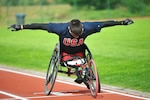 Marine Cpl Ivan Sears prepares for the 100m Wheelchair race of the 2013 CISM Open Integrated/Para Track and Field Championship in Warendorf, Germany 9-16 September.  Sears captured four golds overall in the 100m, 200m, 1500m, and seated shotput.