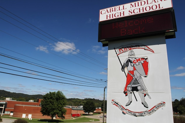 The sign in front of Cabell Midland High School welcomes students back to school Sept. 23, 2013. Cabell Midland, which currently has 411 seniors and 487 juniors, averages three students who enlist in the Marine Corps each school year, with seven to nine more joining during the summer after graduation.  (U.S. Marine Corps photo by Sgt. Tyler J. Hlavac/Released)