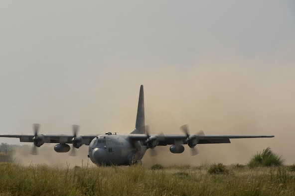 A 774th Expeditionary Airlift Squadron C-130 Hercules cargo plane kicks up dirt on a short runway landing at Forward Operating Base Salerno, Khost province, Afghanistan, Sept. 21, 2013. The 19th Movement Control Team, a small squadron of Air Force surface movement controllers and aerial porters, have the herculean task of overseeing the vast majority of retrograde operations at FOB Salerno.