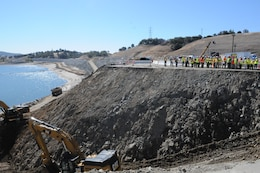 Central Valley Flood Protection Board members and other Folsom Dam auxiliary spillway project partners tour the spillway project construction site Sept. 27, 2013 in Folsom, Calif. Preparation work, shown, is to eventually connect the lake with the spillway.