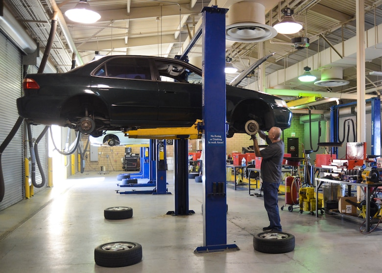 A customer works on his car on a lift at the Edwards Auto Hobby Shop. (U.S. Air Force photo by Rebecca Amber)