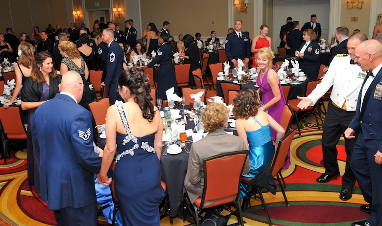 """Attendees of the Air Force Ball take their seats Sept. 27, 2013, at the Renaissance Hotel in Denver. This year's celebration marked the 66th Air Force birthday and paid respects to 1st Lt. John Harold """"Buck"""" Buckley the base's namesake, who was killed during World War I 95 years ago. (U.S. Air Force photo by Senior Airman Phillip Houk/Released)"""