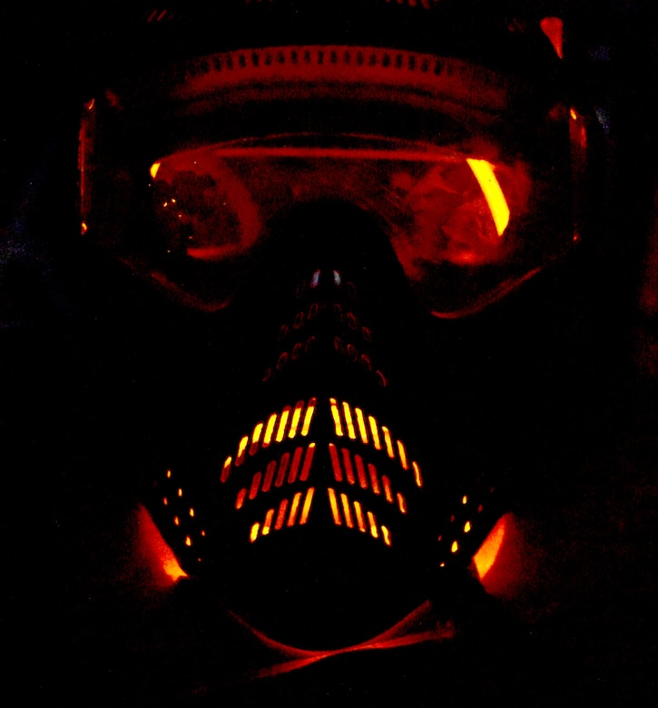 Team Barksdale members wore paintball masks for safety during a nighttime Zombie Apocalypse paintball game on Barksdale Air Force Base, La., Sept. 28, 2013. More than 100 Team Barksdale members participated in the game held on the East Reservation on base. (U.S. Air Force photo/Staff Sgt. Amber Corcoran)
