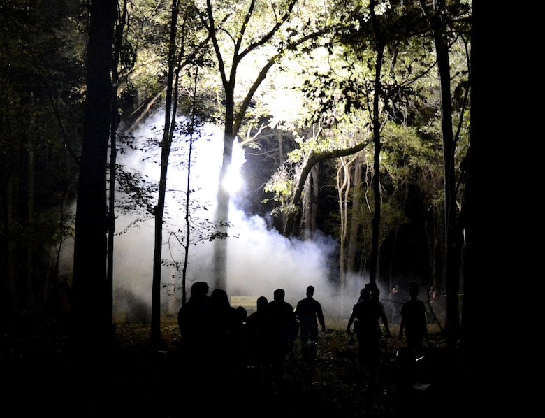 Zombies walk into the woods prior to the start of the Zombie Apocalypse paintball game on Barksdale Air Force Base, La., Sept. 28, 2013. As waves of zombies were released, the humans tried to shoot zombies in the head before they were infected by being shot with paintballs. (U.S. Air Force photo/Staff Sgt. Amber Corcoran)