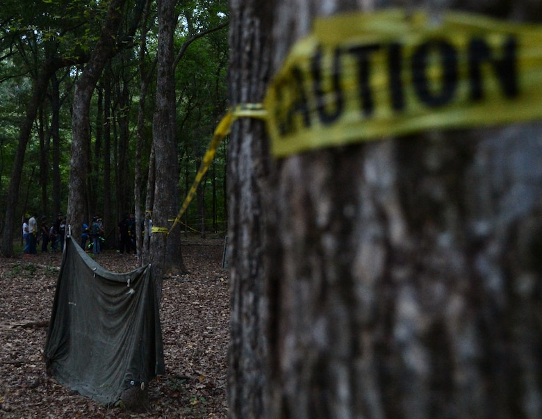 Human-hunting zombies scatter into the woods prior to the start of the Zombie Apocalypse paintball game on Barksdale Air Force Base, La., Sept. 28, 2013. More than 100 Team Barksdale members participated in the game and chose to be a zombie or a human trying to survive the invasion. (U.S. Air Force photo/Staff Sgt. Amber Corcoran)
