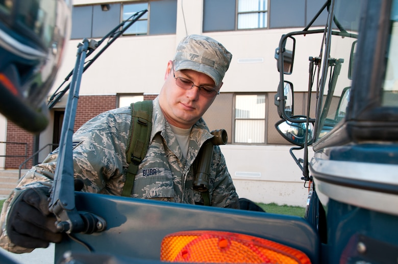 Staff Sgt. Stephen Burr, 108th Communications Flight,  inspects a vehicle  during the annual Quick Response Force (QRF) training September 29, 2013, at Joint Base McGuire-Dix-Lakehurst, N.J. QRF training teaches Guard members how to deal with disturbances when called to duty for civil support. (U.S. Air National Guard photo by Senior Airman Adrian R. Rowan)