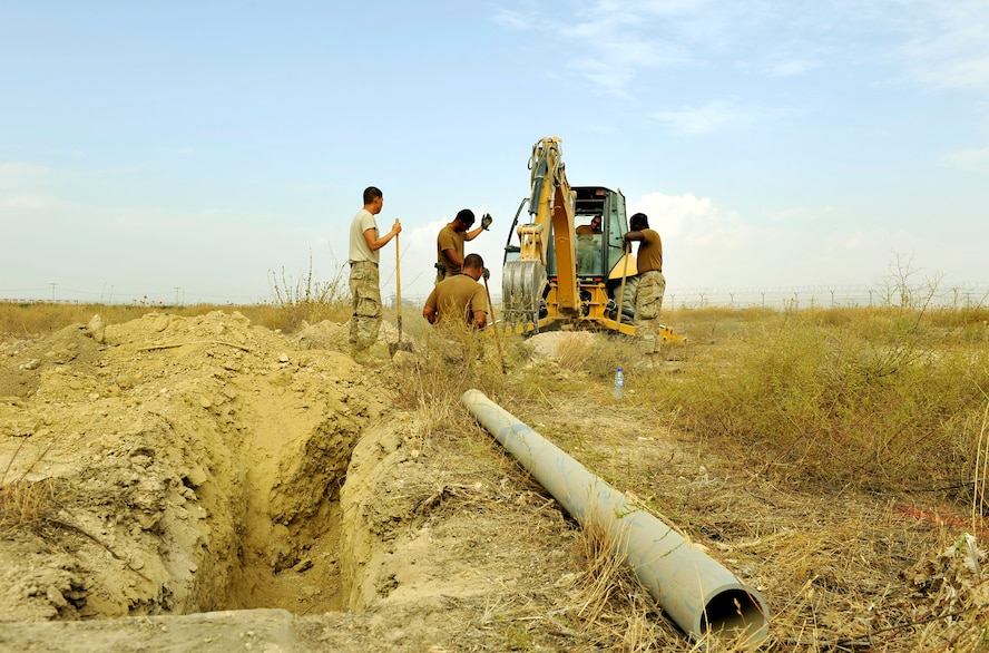 Five Airmen assigned to the 455th Expeditionary Communications Squadron engineering and installation team dig a trench prior to installing fiber cable for the new weather observation system on Bagram Airfield, Afghanistan, Sept. 12. The system is the first to be installed in the area of responsibility and will help the base determine more accurate weather forecast. The Airmen are forward deployed here from 9th Air Force, Al Udeid Air Base, Qatar. (U.S. Air Force Photo/ Staff Sgt. Stephenie Wade)
