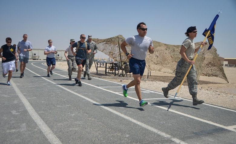 Service members kick off a 24-hour Tactical Air Control Party remembrance run at Al Udeid Air Base, Qatar, March 27, 2014. The event was held to ensure those warriors who have made the ultimate sacrifice are never forgotten. This year's 24-hour TACP challenge was the third annual event dedicated to the 10 fallen TACP warriors who were killed in combat and training operations within the last 20 years. The event was held world-wide with every TACP unit starting the run March 27 at noon local time. (U.S. Air Force photo/Senior Airman Jared Trimarchi)