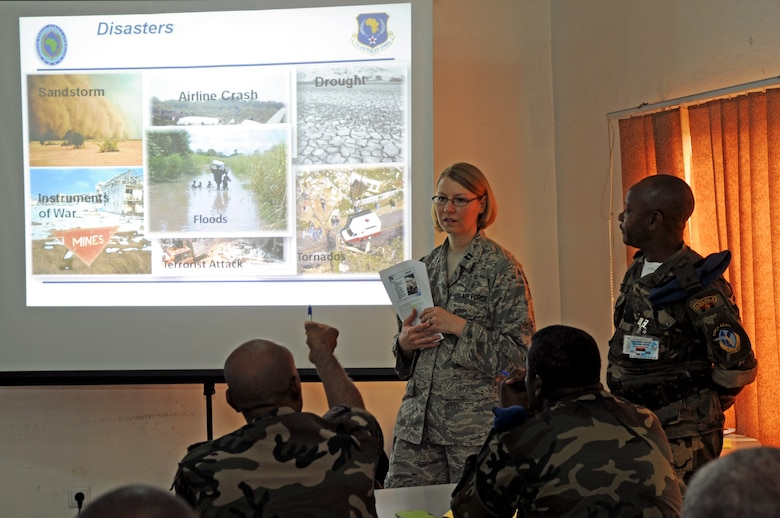 Capt. Danielle Butler briefs students on natural disasters March 24, 2014, in Angola, Africa. The intention of APF is to strengthen the regional partnerships within Africa by improving the proficiency and readiness of key mission areas through a collaborative learning environment. Butler is a  U.S. Air Forces in Europe and Air forces Africa surgeon general specialist. (U.S. Air Force photo/Capt. Sybil Taunton)