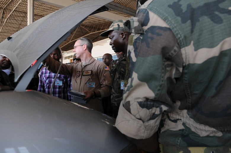 Senior Master Sgt. Phillip Leonard leads discussions vehicle inspections March 24, 2014, in Angola, Africa. The intention of APF is to strengthen the regional partnerships within Africa by improving the proficiency and readiness of key mission areas through a collaborative learning environment. Leonard is the African Partnership Flight lead planner. (U.S. Air Force photo/Capt. Sybil Taunton)