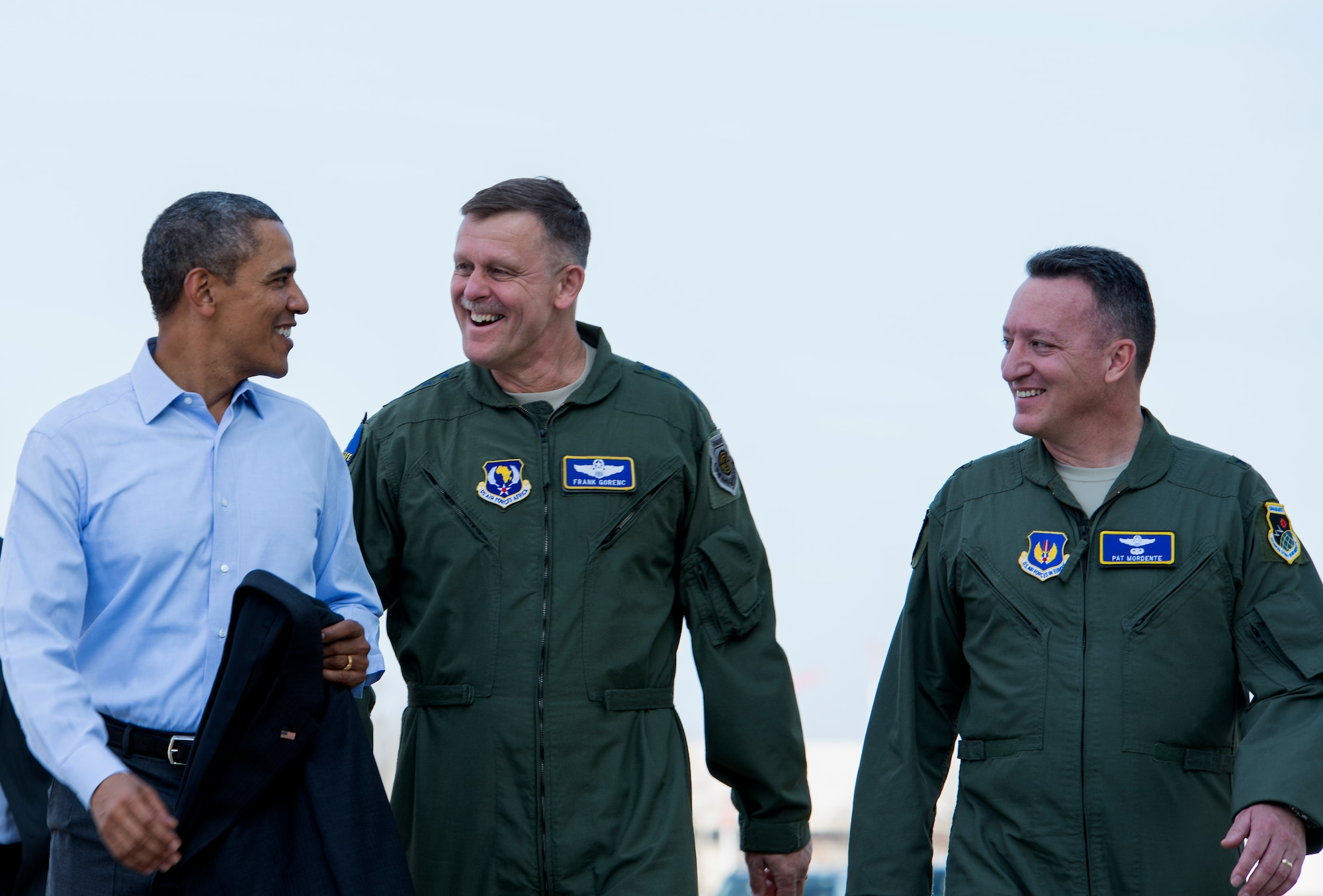 President Barack Obama speaks with Gen. Frank Gorenc (middle), U.S. Air Forces in Europe and Air Forces Africa commander and Brig. Gen. Patrick X. Mordente, 86th Airlift Wing commander, March 29, 2014, at Ramstein Air Base, Germany. During his stop, Obama visited wounded warriors from Landstuhl Regional Medical Center. (U.S. Air Force photo/Senior Airman Damon Kasberg)