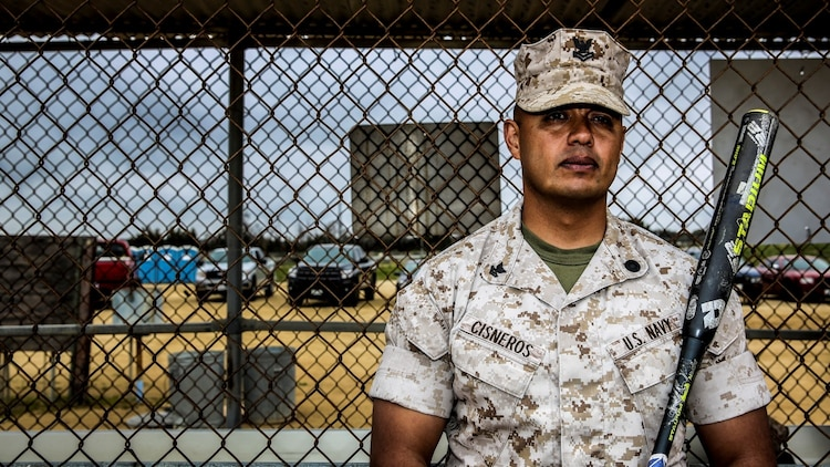 Petty Officer 2nd Class Gabriel Cisneros, religious program specialist, 15th Marine Expeditionary Unit, poses for a photo during a softball practice aboard Camp Pendleton, Calif., March 24, 2014. Cisneros, 36, is from Diamond Bar, Calif.  (U.S. Marine Corps video by Cpl. Emmanuel Ramos/Released)